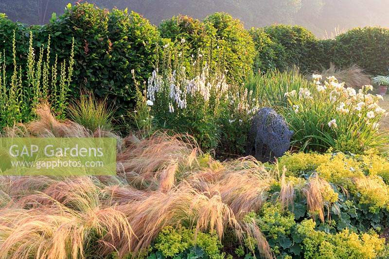 Mixed border of ornamental grasses and flowering perennials.