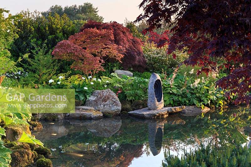 A Meditation Garden, view across water to the focal stone sculpture on 