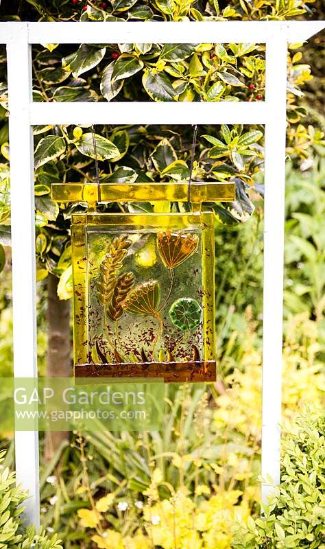 Hanging panel of semi-transparent material with seedhead art works