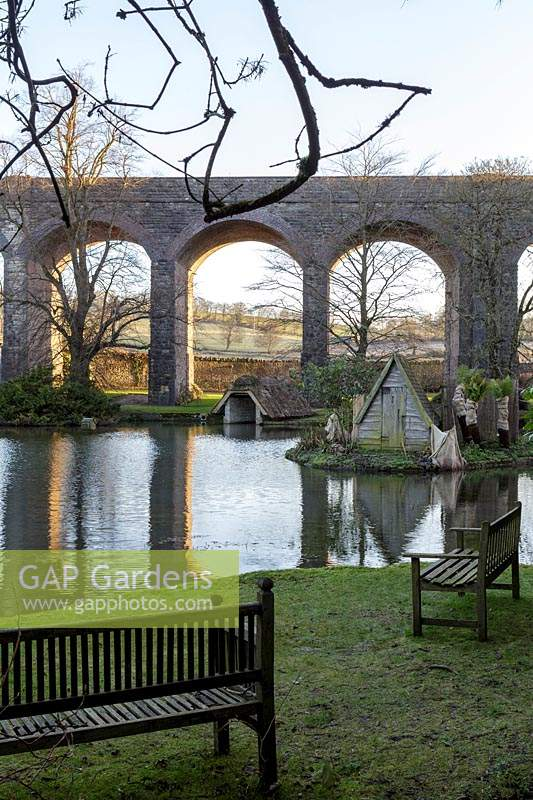 View across lake to viaduct at Kilver Court, Somerset, UK. Designed by Roger Saul of Mulberry.
