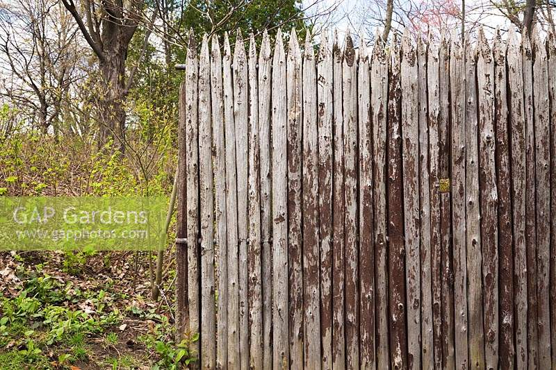 Fence made with wooden stakes called a palisade, Montreal Botanical Garden, Quebec, Canada.