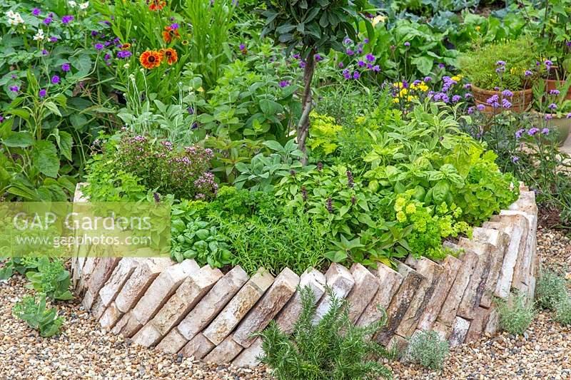 Gap Gardens Circular Raised Brick Bed With Mixed Herbs In