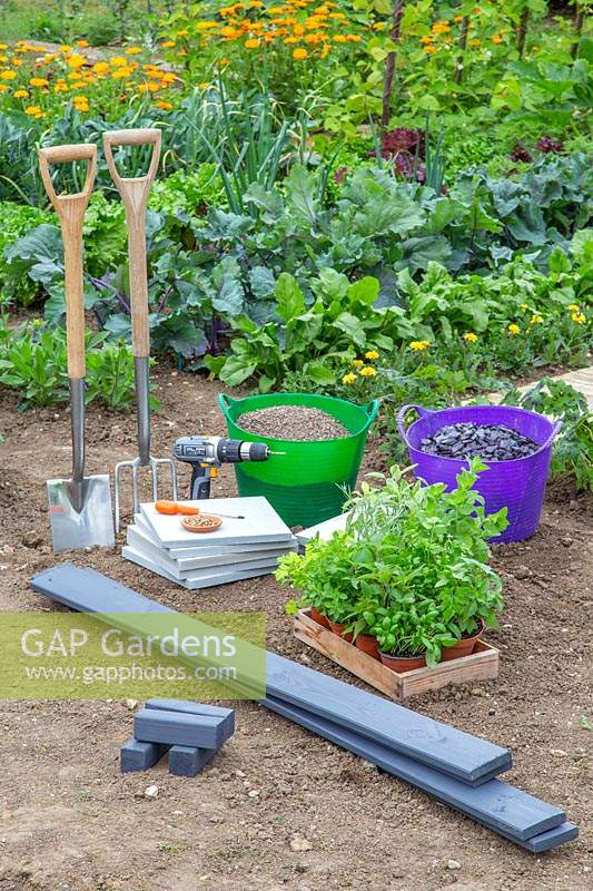 Material and tools for creating a herb checkerboard garden