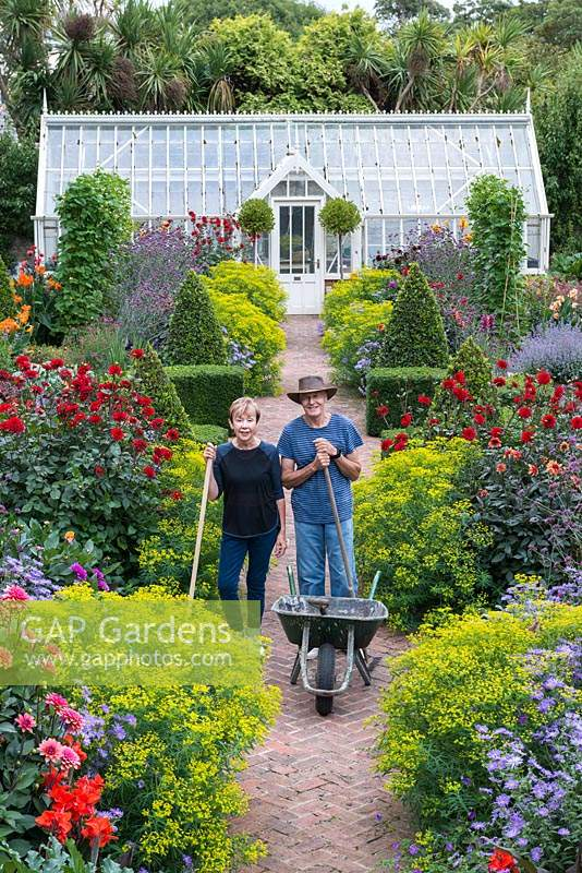 Steve and Phillippa Lambert, in the walled garden they rescued from dereliction, and restored as an early Victorian kitchen garden.