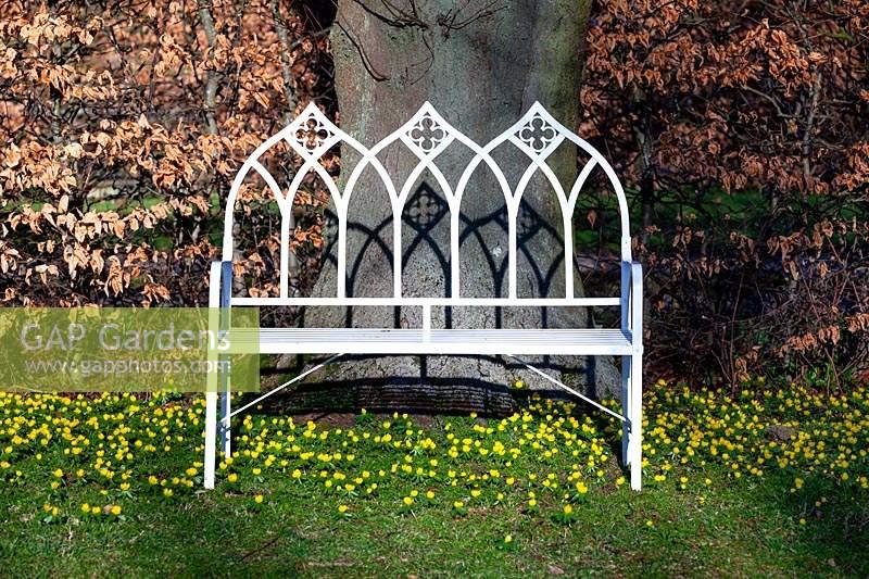 Amazing Gap Gardens White Iron Bench On A Carpet Of Flowering Machost Co Dining Chair Design Ideas Machostcouk