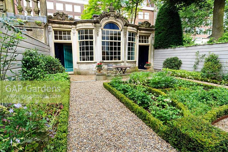 The garden at Huis van Brienen, restored by Saskia Albrecht and funded by the Canal Garden Fund, which uses the money from the open garden days to resource restoration of the canal house gardens. Amsterdam, The Netherlands.