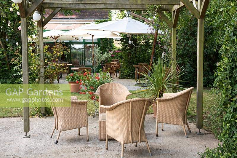 Patio area with outdoor furniture. Garden of the Auberge de Launay, near Amboise, Loire Valley, France