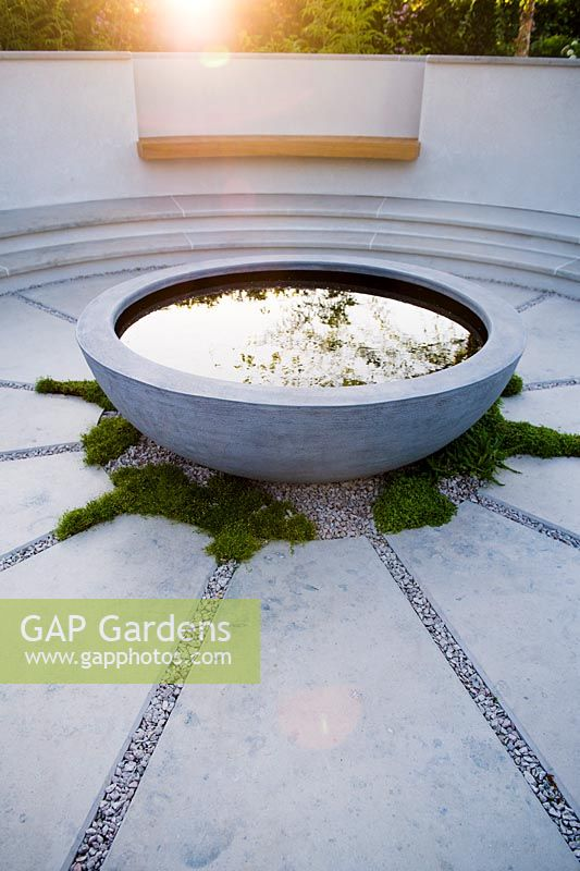 Concrete round water feature. The South West Water Green Garden at RHS Hampton Court Palace Flower Show 2018