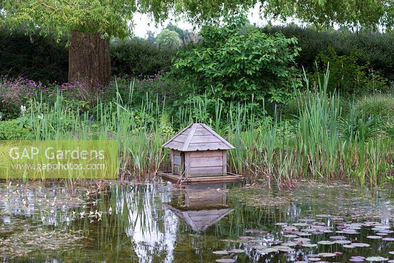 In the wildlife pond, a duck house.
