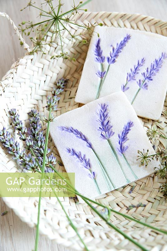 Decorative tiles made from salt dough and pressed and painted lavender flowers