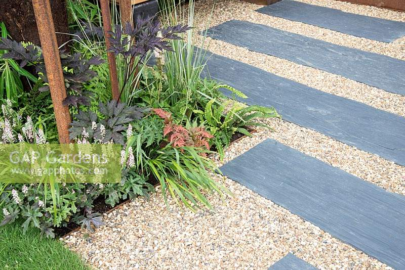 Slate and gravel path in the Bee's Gardens: The Penumbra, RHS Tatton Park Flower Show 2018