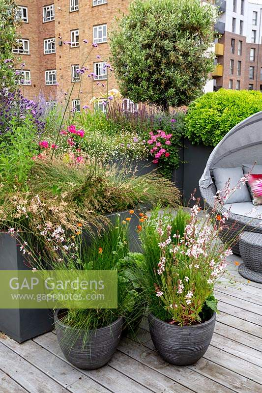 Gap Gardens Roof Terrace With Wood Decking And Garden Sofa With Built In Shade With
