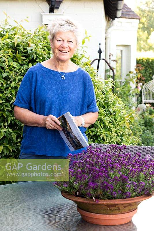 Woman in garden with plant catalogue