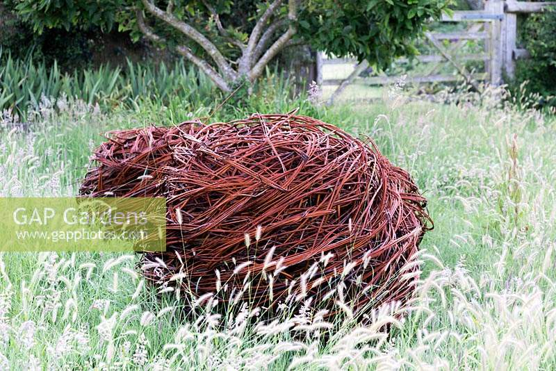 Woven Salix - Willow  - sphere set in long grass Sussex