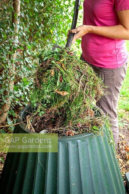 Adding suitable material to a compost bin