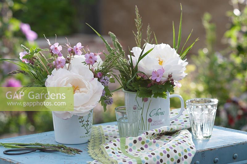 Small bouquets with peony flowers, cranesbill, mountain savory and grasses.