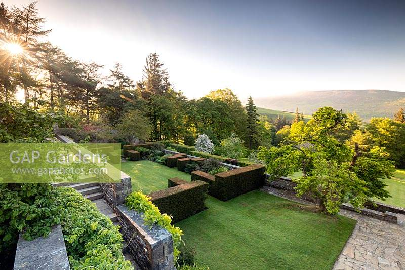 View over the Terraces towards Simon's Seat in the distance, at Parcevall Hall Gardens, Yorkshire, UK.