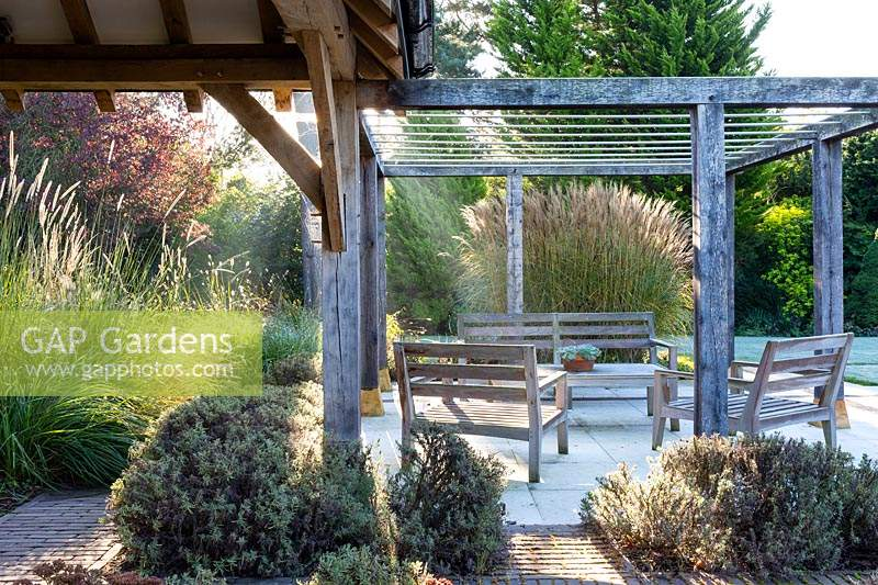 View of pergola and patio at Surrey Garden designed by Amanda Patton.