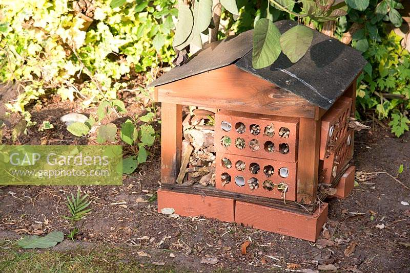 Bug hotel made from wood, slate and bricks