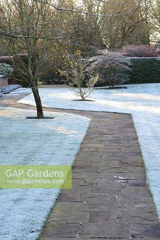 York stone paving by frosty lawns.