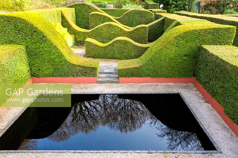 View over the Reflecting pool and Hedge Gardens. Pool water is dyed black. Hedges are of Taxus baccata.