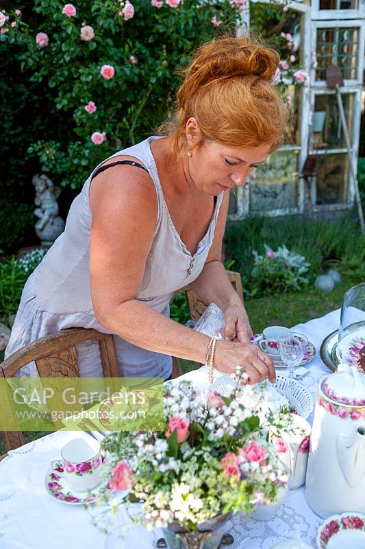 Woman setting a garden table