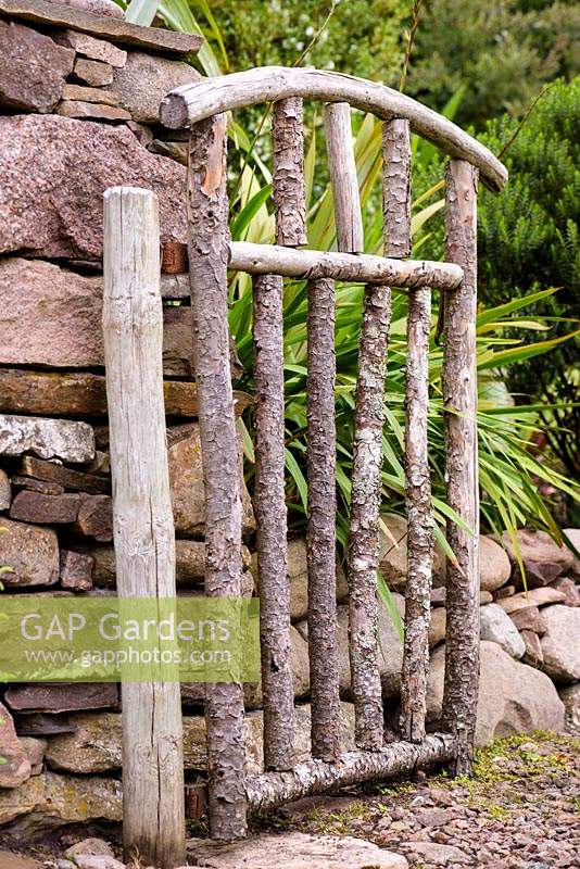 Rustic garden gate at a private garden on Little Loch Broom, Wester Ross, Scotland.