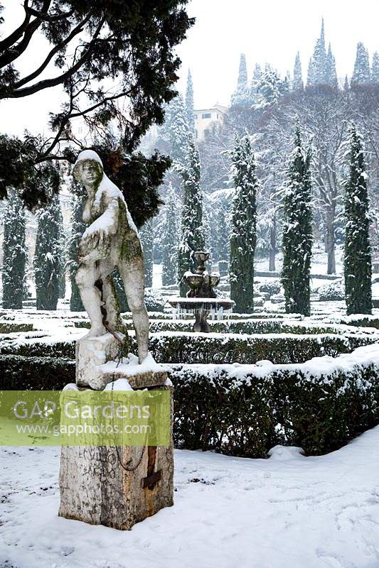 Classic sculpture next to The French Parterre, Giardino Giusti, Verona