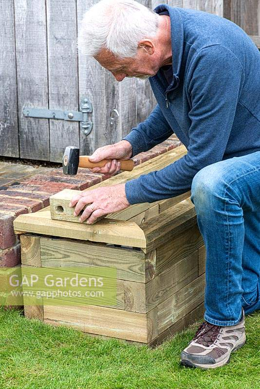 Man building raised bed