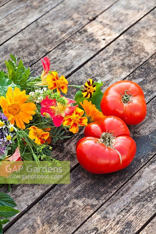 Harvested tomatoes and edible flower bouquets.