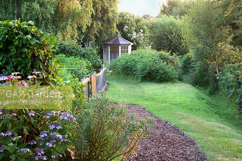 Country garden with summerhouse.