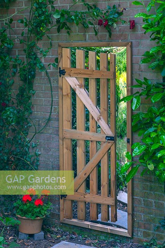 false gateway with mirror in the garden to give the illusion of space  Norfolk