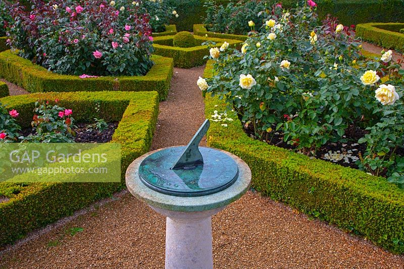 Formal garden with sundial and Buxus parterre - Waterperry Garden, Oxfordshire