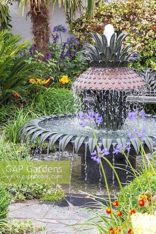 Decorative water fountain in Great Gardens of the USA, The Charleston Garden, RHS Hampton Court Palace Flower Show, 2017 Design: Sadie May Studios Ltd.