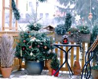 Balcony with decorated christmas tree