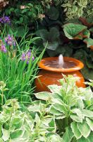 Terracotta urn water feature - water spouting from container