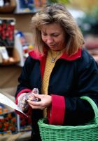 Woman looking at bulbs at Garden Center in autumn