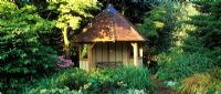 Summer house by pond at Foggy Bottom, Bressingham Gardens Norfolk