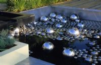Modern pool wth metallic glass spheres at Hampton Court FS 2001.