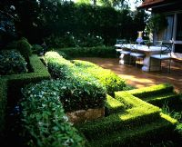Courtyard with zig zag hedges and furniture
