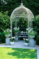 Gap gardens decorative metal gazebo with containers at the little cottage lymington image - Gloriette fer smeden ...