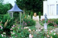 Gazebo in formal rose garden with Statue at Kettle Hill, Norfolk
