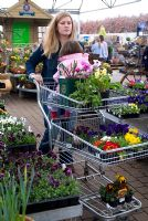 Family in Plant Centre with trolley loaded with plants