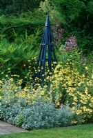 Blue tripod surrounded by Anthemis tinctoria 'E C Buxton' and Artemisia ludoviciana 'Velerie Finnis' - Arrow Cottage, Herefordshire