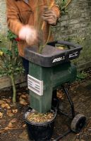 Using a quiet compost shredder to process woody prunings