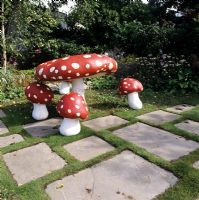Sculptured mushrooms in garden setting - 'Garden of Reflection' Hampton Court