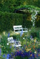 Delphinium, Salvia, Aquilegia ,Geum, white seats and pergola in sunken Garden inspired by Karl Foerster - The Daily Telegraph Garden, Chelsea 2007