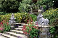 Sphinx below lower rose terrace with  Valerian and Campanula growing in stone crevices  at Bodnant garden in North Wales.