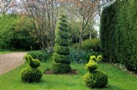 Boxwood topiary spiral and animals - Old Place Farm, Kent