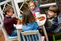 Children eating outside at a barbecue